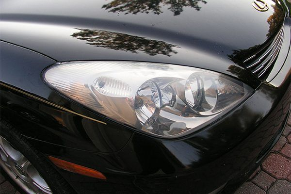 It doesn't matter how fast your car is, you can only drive as fast as you can see down the road ahead of you. When the plastic lenses on your headlights get hazy and oxidized, they disperse the light and reduce your visibility. Here's how to clean them.*For more car cleaning ideas, see [Homemade Auto Glass Cleaner...