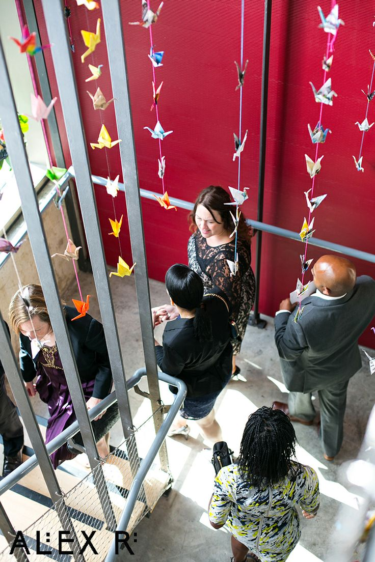 Guests following the trail of paper cranes up to the ceremony