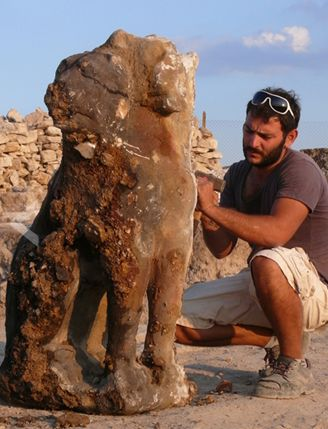 """In the ancient city of Hierapolis in southwestern Turkey, a marble statue depicting the three-headed dog Cerberus has been unearthed at """"Pluto's Gate,"""" a thermal springs that in ancient times was believed to be an entrance to the underworld."""