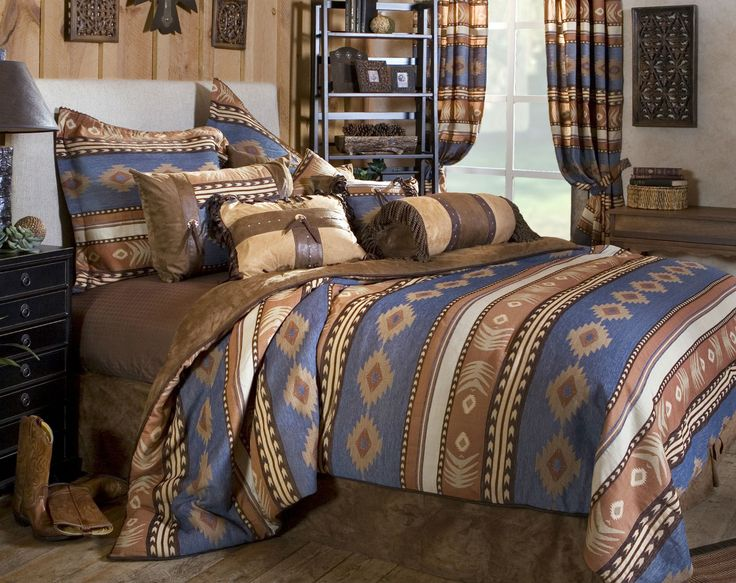 Sierra by Carstens Lodge Bedding infuses the bedroom with transitionally inspired hues of browns, tans and blue. Rich, warm hues invite you for a slumber surrounded by quality linens, specialty finishes and innovative textures. The comforter features your favorite colors in southwestern motifs and stripes. Introducing decorative fringes, trims, and pieced stitching the decorative accessories and shams take the pattern to a more luxurious setting. Euro shams, decorative cushions, coordinating…