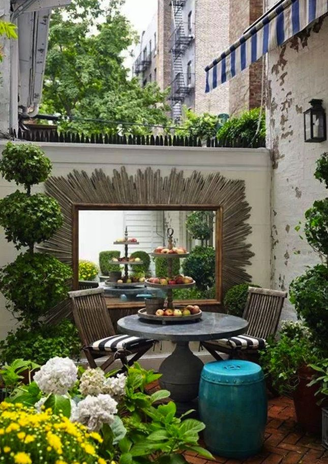 "Reflect the Sun: We talk about using mirrors inside to make a room feel larger, so why not take the same strategy outside and ""double"" your outdoor garden space? (via House and Garden)"