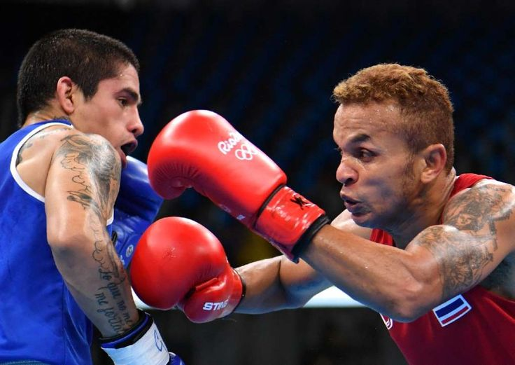 From jailbird to Rio boxing history-maker  -  August 8, 2016  -     Thailand's Amnat Ruenroeng (R) fights Argentina's Ignacio Perrin during a men's light (60kg) bout on August 7, 2016