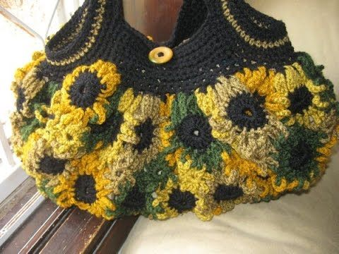 Crocheted Purse made of flowers. Made of motifs and crocheted together. This Crochet Purse pattern is very easy to follow and the pattern has pictures to hel...