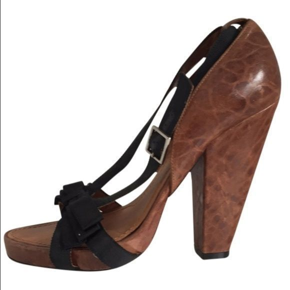 GIVENCHY Pebbled Leather & Ribbon Brown Platforms Ginenchy chunky heel platform peep toe sandal pumps. Size 38 minimal wear great condition. Minor scuffs on bottom and front. Beautiful pebbled leather. Condition: Gently used Scuff on solesExterior scuffs or marks Givenchy Shoes Platforms #chunkyplatformpumps #givenchyshoeshighheels