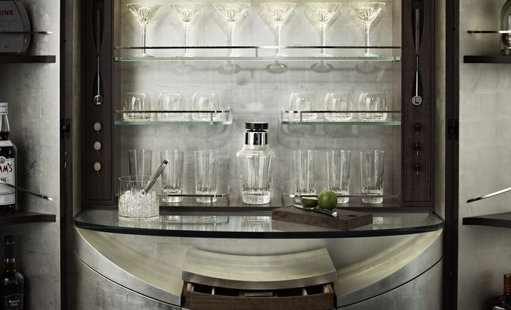 A super chic bar cabinet designed by David Linley. Follow the link to see more pictures of this extraordinary and beautifully crafted piece of furniture called the 'Tectonic Bar' which opens using a secret button. How James Bond!