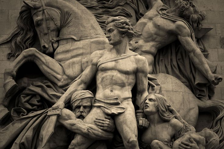 A particularly heroic scene depicted in a statue at the base of the Arc de Triomphe in Paris, France