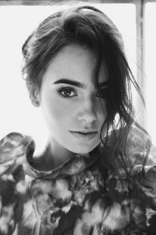 Lily Collins. She looks so much like my Liv sometimes, it's eerie.