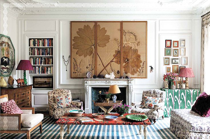 Carolina Irving home in Paris: Artwork over mantle is gunnera leaves taken at night.   Some of the worlds largest leaves, this is just fabulous and is definitely the focal point of the living room.