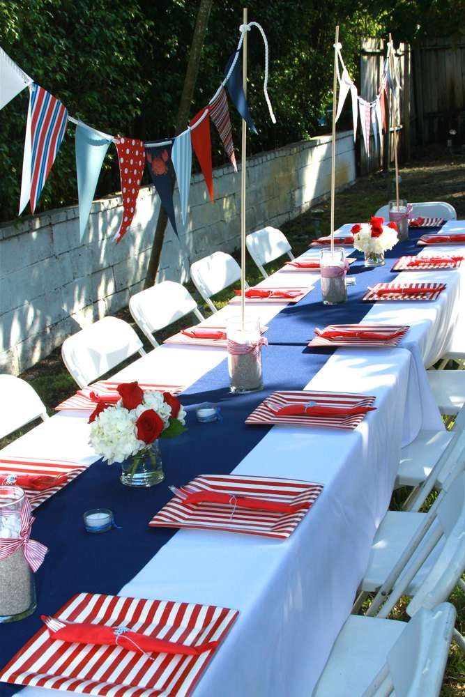 Nautical Baby Shower Party Ideas | great table set up with banners for nautical or sailboat party