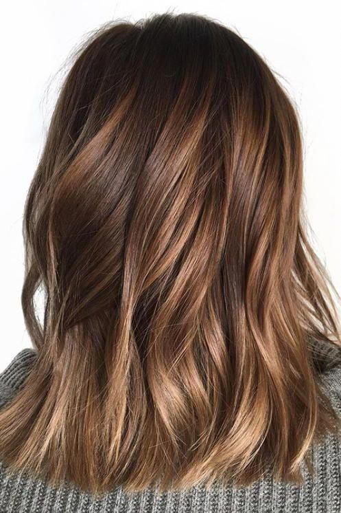 For those who just want a low maintenance, not-too-noticeable change to their classic chocolate brown, these honey-tinged tresses will do the job. Ribbons of randomly placed honey balayage highlights add just the right amount of shine and reflection. #chocolatebrownhair