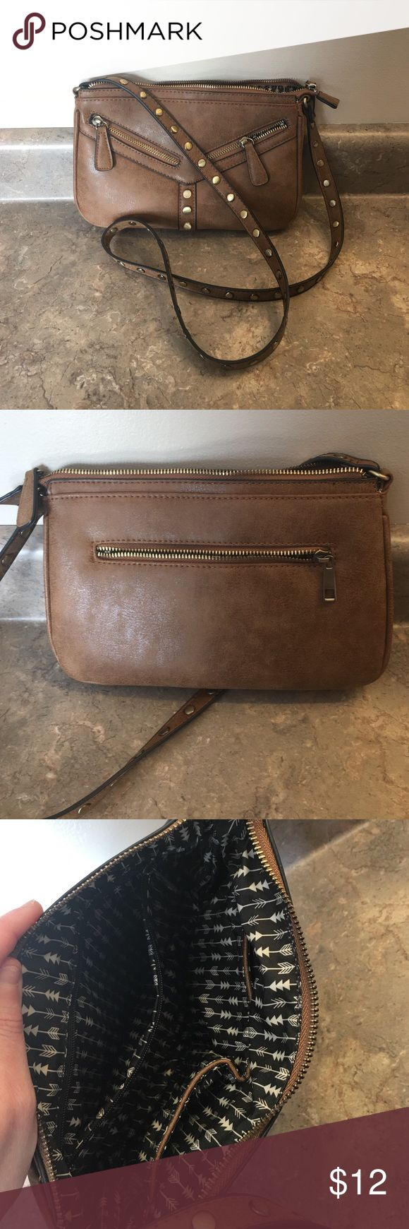 Small Studded brown crossbody bag!  Super cute! Very cute small crossbody bag with bronze stuffed accents!  Used once and in excellent condition! Francesca's Collections Bags Crossbody Bags