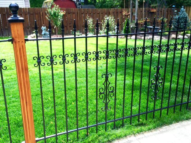 Using Wood Posts With Wrought Iron Fence For A Custom Look Iron