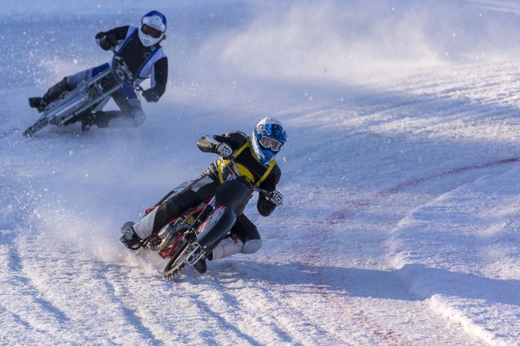 Ornskoldsvik,Sweden - February 10,2018 Two ice speedway drivers in a curve in a Qualifying race for Swedish championship, picture from Northern Sweden.