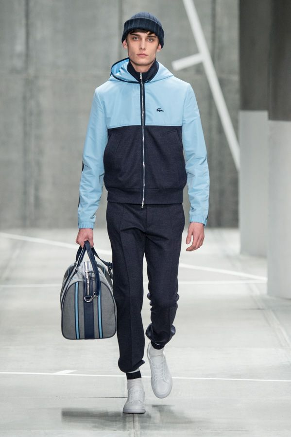Protective tracksuit, white sneakers and elegant sport bag from the #LacosteFW15 fashion show presented Saturday in New-York City. © Yannis Vlamos