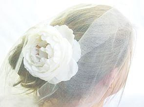Peony hair flower by Loveflowers. Find your perfect wedding flowers at http://www.loveflowers.com.au/