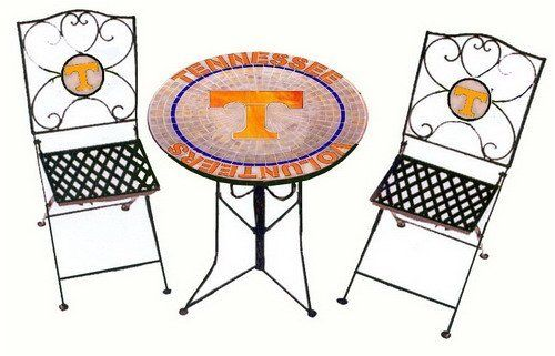 "Tennessee Volunteers Bistro Table and 2 Chairs by Traditions. $279.99. Officially Licensed Product. Chairs: Stained Glass mosiac school logo in wrought iron chair backs. Table: Genuine Leaded Stained Glass Mosaic top on mortar base - wrought iron. Dimensions: Table 27"" dia. X 30"" tall.. Tennessee Volunteers Bistro Table and 2 Chairs - Show Your Team Colors with this Officially Licensed high quality product by Traditions ArtGlass Studios. Beautifully handcrafted decorativ..."
