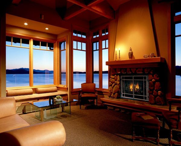 Bedroom Stone Fireplace Ideas And Roof Lamps With Brown Carpet Chairs Glamorous Living Room Decorating Glass Windows Sea Views