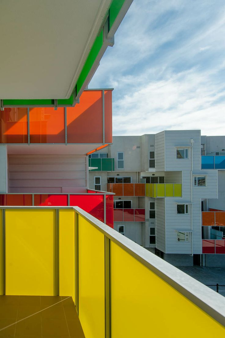 Coloured Glass Balconies.  Atherton Gardens Bird de la Coeur Architects with McCabe Architects. Photo John Golings