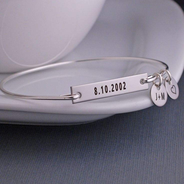 Each bangle is hand formed from heavy gauge sterling silver wire and then hand-hammered and tumbled for shine and strength. A stainless steel rectangle measuring 1 1/4 inch across is engraved with the
