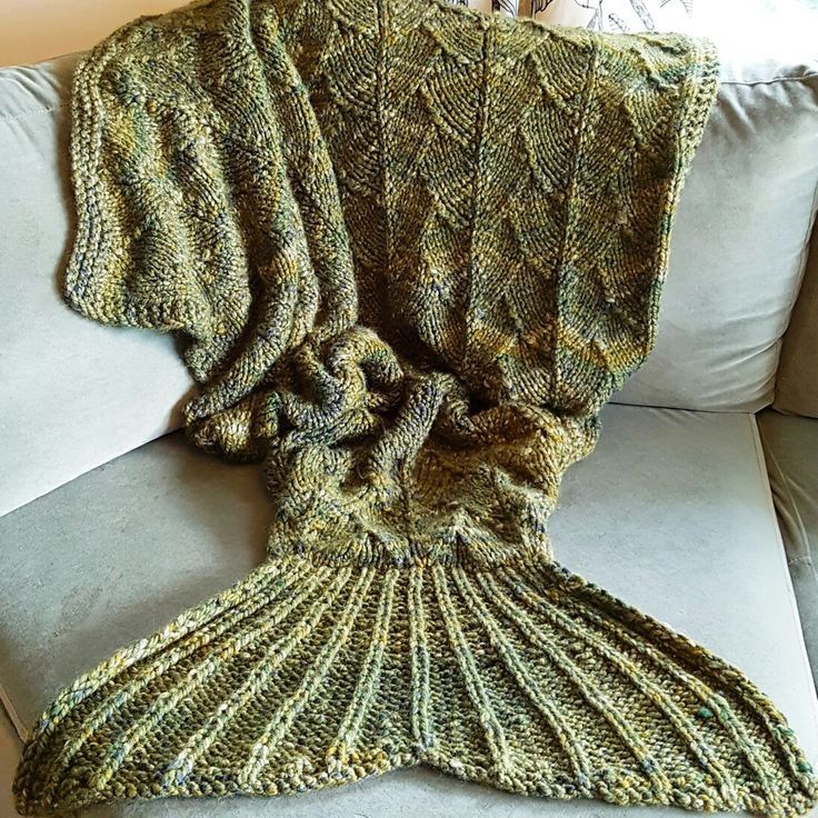 Knitted mermaid tail blanket for my friend. Design is from my own head. I used modified dragon scale pattern.