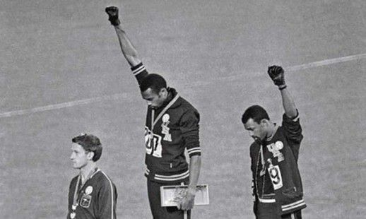 The 1968 Mexico City Olympics, Black Power Salute. Tommie Smith and John Carlos raised their fists on the podium in a silent salute against racism in the United States. Both were expelled from the games.