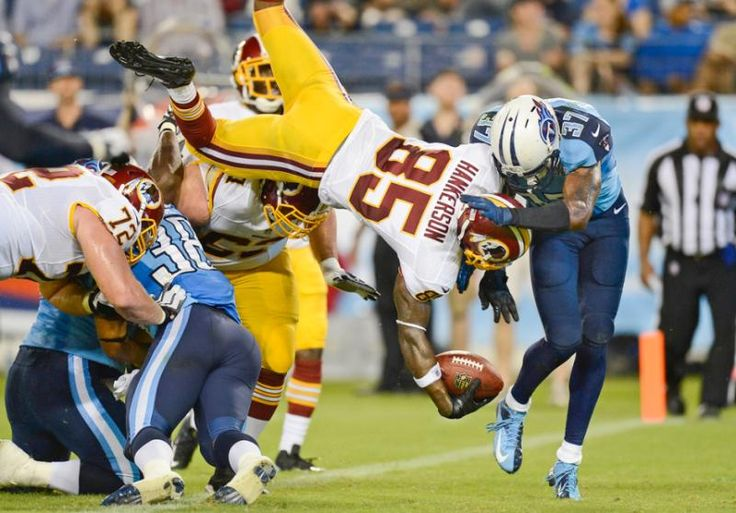 Washington Redskins wide receiver Leonard Hankerson (85) flips into the end zone as he scores a touchdown on an 8-yard pass play against the Tennessee Titans in the second quarter of a preseason NFL game on Thursday, Aug. 8 in Nashville, Tenn. (Mark Zaleski/AP)