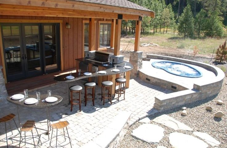 This stone patio would offer great support for a  #HotSpringSpa! Complete with an outdoor bar area and dining section for entertaining.
