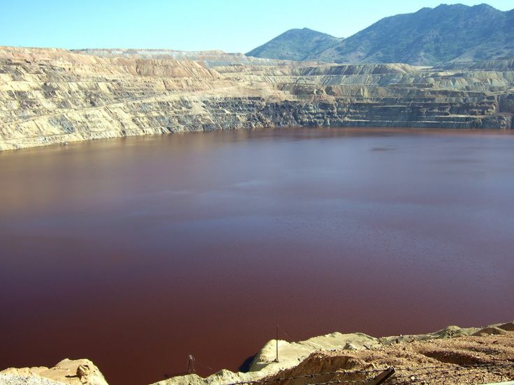"""Actually """"not so cool geology.""""  The Berkeley Pit is filled with highly acidic water that contains a lot of toxic chemicals. It is a Superfund nightmare. Only pumping keeps the toxic water below the water table of Butte, Montana. Ugh. What a mess!"""