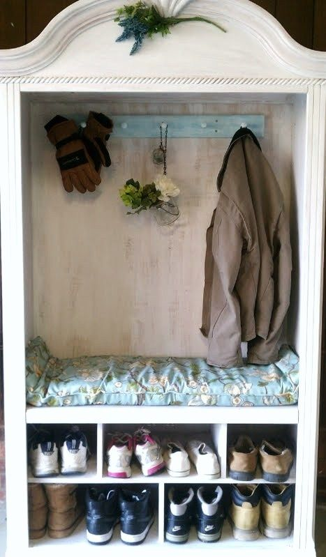 An old TV Armoire I turned into a coat/shoe organizer w/bench. Removed the shelf and glass doors, added some white paint, attached a coat hook that I painted aqua, then whitewashed. added a cushion for the bench and voila~ a useless piece of furniture is now a practical mudroom piece.