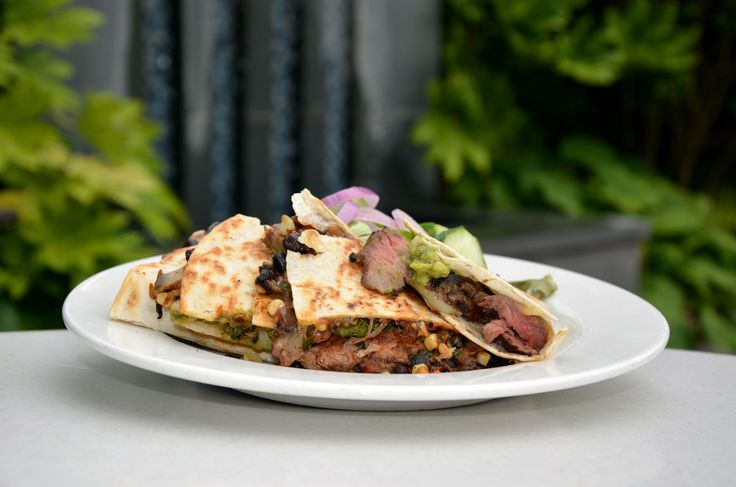 Grilled flank steak quesadilla with black bean and corn salad, pepper ...