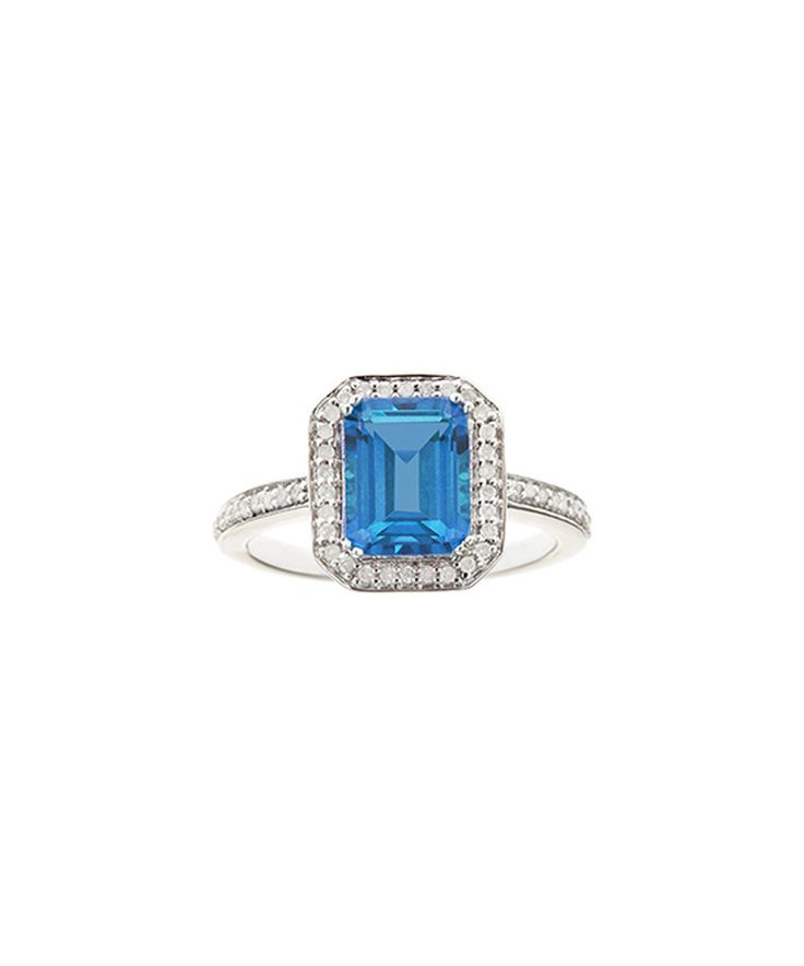 Take a look at this Blue Topaz & Diamond Emerald Cut Ring today!
