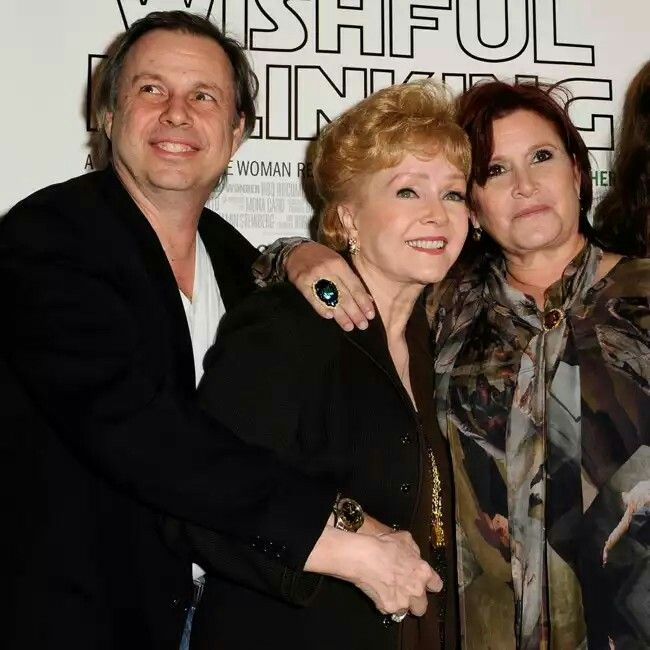 DEBBIE REYNOLDS WITH ACTOR SON TODD FISHER & ACTRESS DAUGHTER CARRIE FISHER. CARRIE DIED ONE DAY BEFORE HER MOTHER DID.