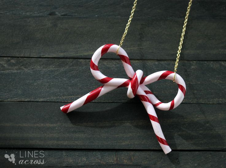 Here's a sweet idea— a Candy Cane Bow Necklace (or Ornament) made from polymer clay (via Lines Across)
