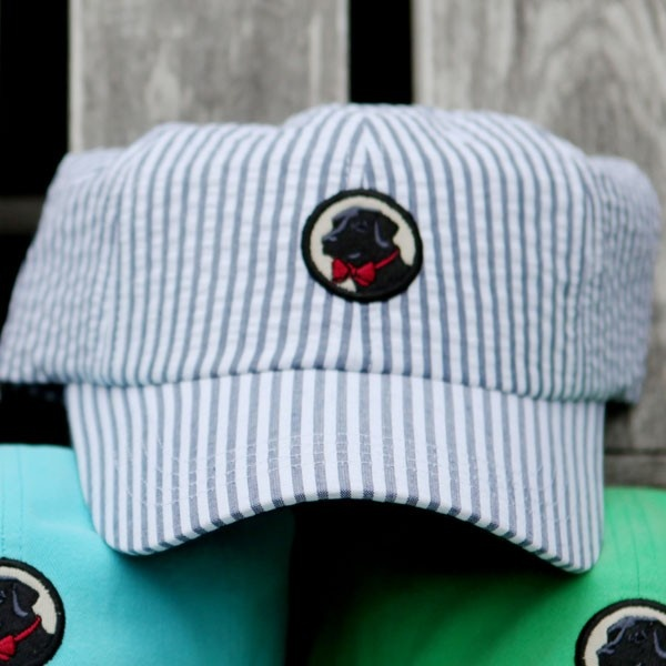 You can't dress from head to toe in seersucker without a seersucker hat, so quit wasting time and add this to your cart. Southern Proper's Frat Hat in blue seersucker is direct evidence of why It's Good to Belong. That thing looks so amazing. Buy it immediately.    - One size fits all   - Made from seersucker, so you know it's good   - It has a dog on it