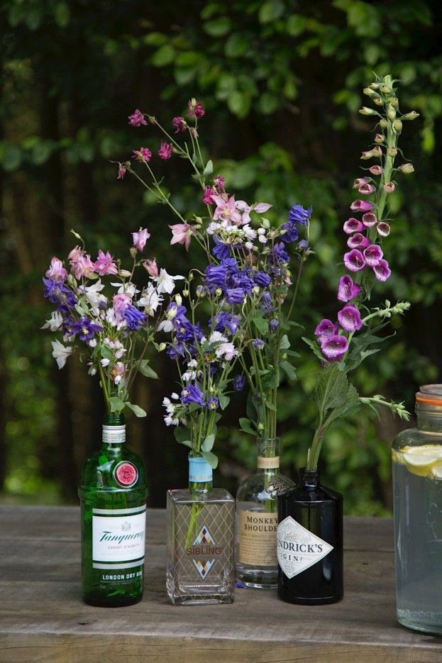 As huge gin fans Lucy and Tristan used old empty bottles for flower vases.