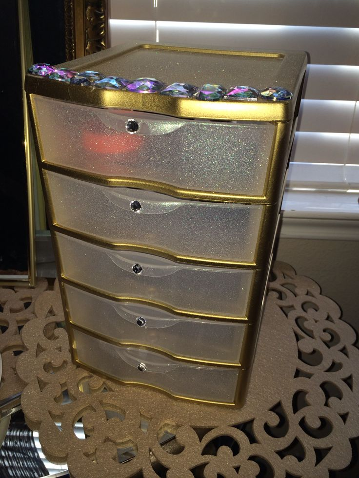 STERILITE plastic drawer from walmart for about $9, sprayed GOLD and GLITTER KRYLON spray paint and hot glued GEMS, and baaam!! Make up storage or hair storage for the GOLDEN GODESS you are!!;)