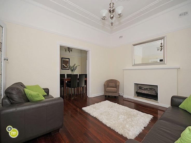 This vintage fire place matched with the jarrah floor looks like just the perfect place to snuggle this winter.