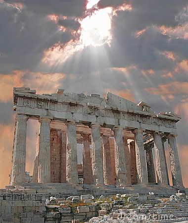 Sun bursting through the clouds over the Parthenon Acropolis in Athens, Greece