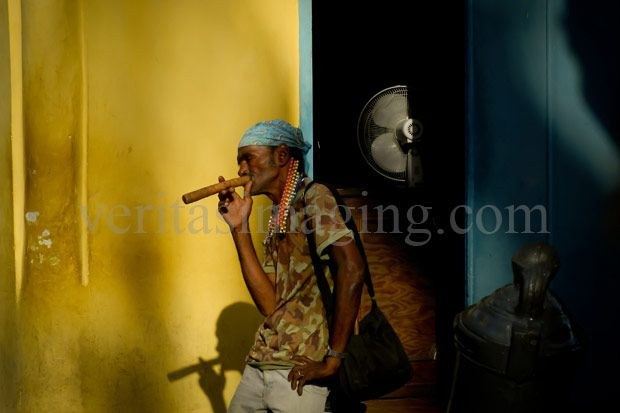 A man with a huge cigar in old Havana, Cuba.