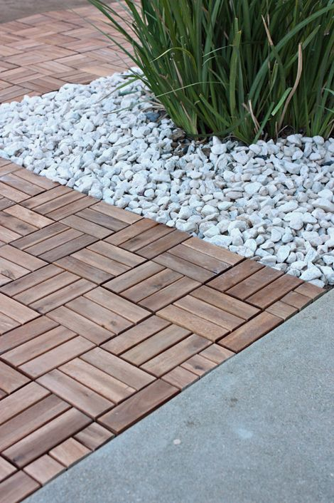 Love the combination of the stone with plantings, and the deck--whatever the design of the wood.