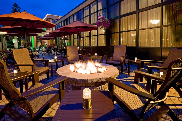 outdoor terrace and fire place holiday inn saratoga