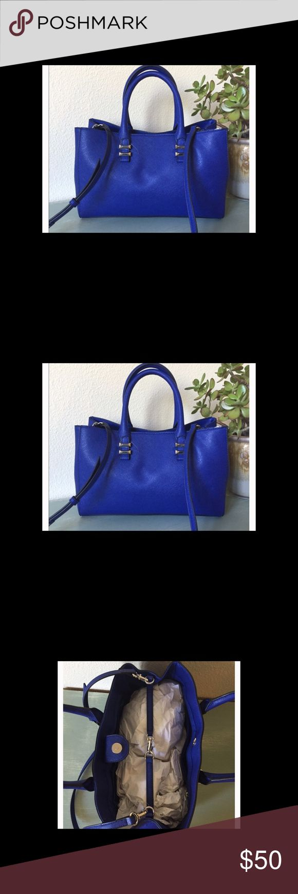 """Banana Republic tote Brand new blue buckle  tote from BR. No tardes . Bag is gorgeous. Selling at lowest price . No offers . Bag measurements are 12x8x5 strap 33'-37"""". Handles is 15"""" Banana Republic Bags Totes"""