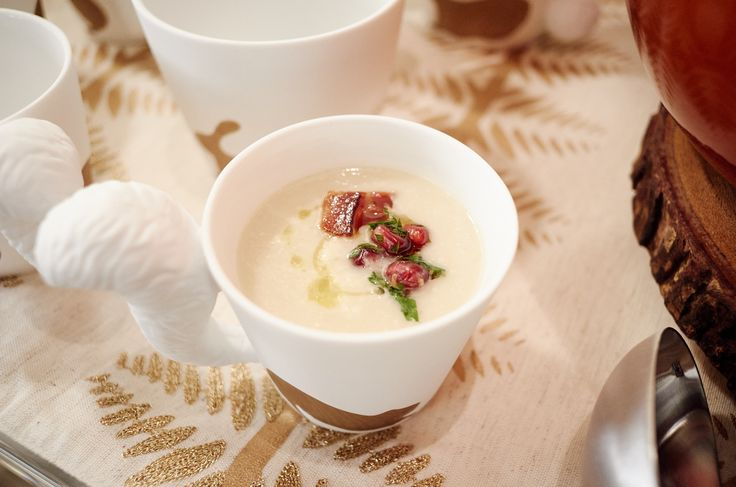 Creamy white velvet soup topped with crispy bacon, parmesan and a pomegranate gremolata... serve in soup cups for a party so guests can walk around with it!