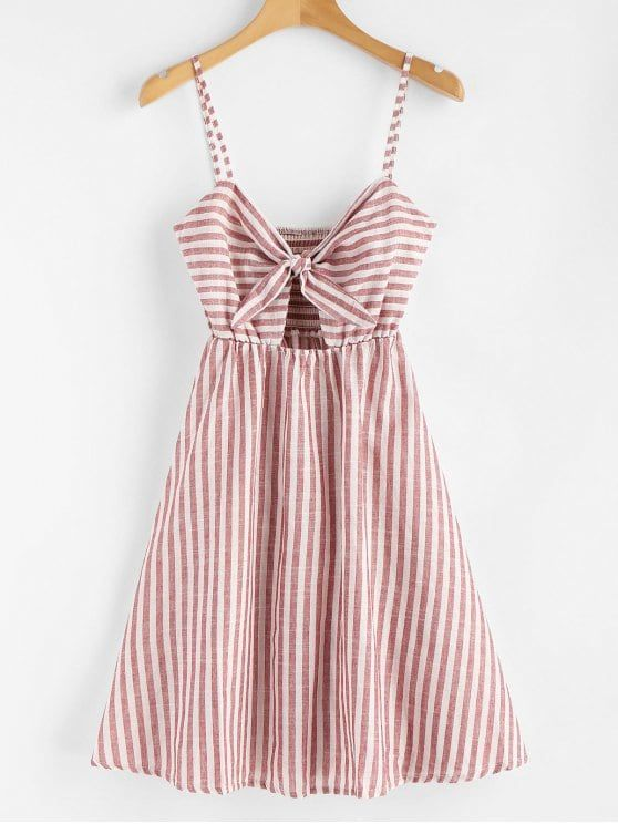 Smocked Knotted Stripes Dress. With an allover adorable stripes pattern and a subtle empire waist, this cami dress is a perfect pick for every event on your day-to-night calendar. A tie-front design that creates a slight cutout detailing on the bodice and the stretchy smocked back add a little flirty feel to the casual style. Just pair it with heels to show off a bit. #Zaful #Dress #Outfits - Rebecca Reilly