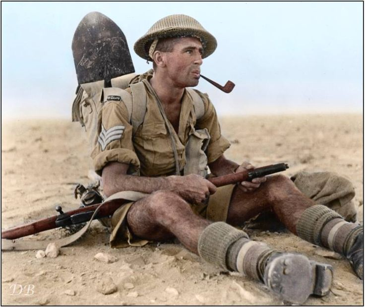 New Zealand Army Sergeant Ian Thomas of the 25th Battalion, 6th Infantry Brigade, 2nd NZEF smoking a pipe during the North African Campaign, near Ruweisat Ridge in Egypt 1942.