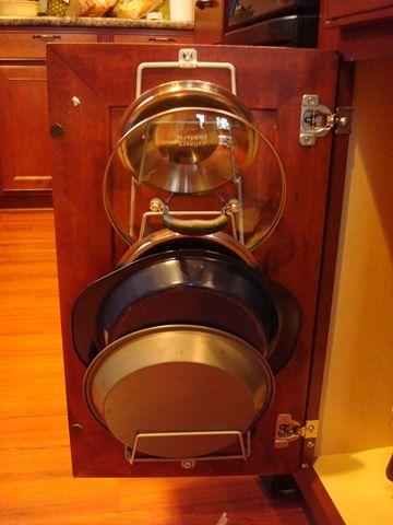 kitchen storage - hang the pot lids on the cabinet door!