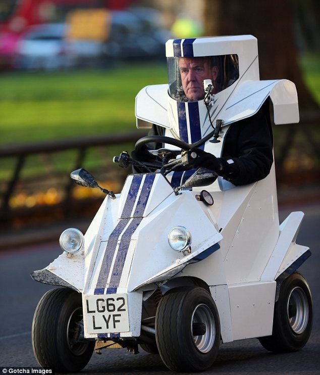 To infinity and beyond! Jeremy Clarkson looks like a character from Toy Story as he drives round Mayfair in futuristic car