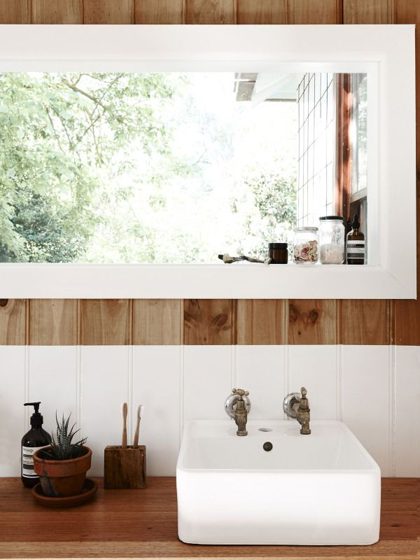 Bathroom. Window made from an old door.  Photo by Eve Wilson, styling by Stefanie Stamatis for The Design Files.