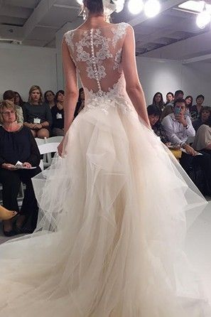 Sleeveless Spring 2016 wedding gown with full skirt and lace statement back from Maggie Sotterro.