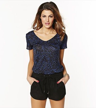 Give a spin to your everyday look with this blue african shirt featuring a high low hem.